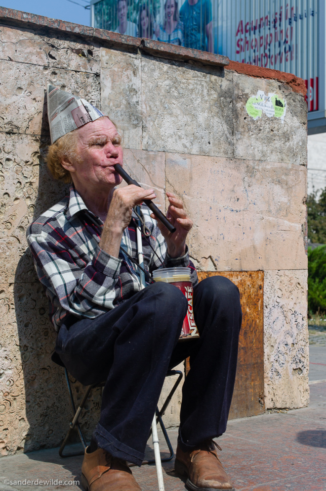 Moldova Chisinau Blind man plays the flute at the entrance of the underground crossing with a paperhat, to earn some money
