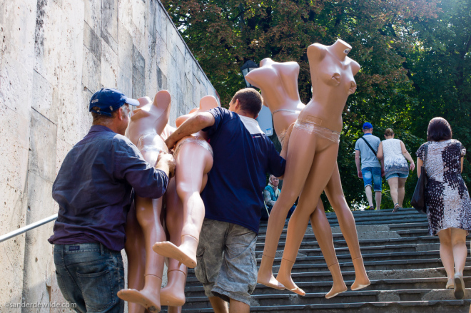 Moldova Chisinau Guys bring up naked mannequins in the center of Moldova